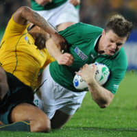 Former Ireland captain Brian O'Driscoll (right), seen competing in a 2011 Rugby World Cup match against Australia, represented his nation in 133 matches during his career. | AP
