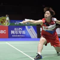 Akane Yamaguchi hits a shot during her match against Yeo Jia-min on Tuesday in Basel, Switzerland.  KYODO