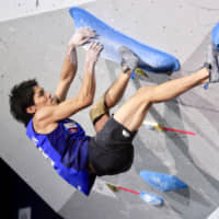 Tomoa Narasaki works his way through a bouldering route during the men's combined event at the IFSC World Championships at Esforta Arena Hachioji on Wednesday.   KAZ NAGATSUKA