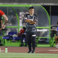 Shonan Bellmare manager Cho Kwi-jea watches his team play Brazil's Athletico Paranaense on Aug. 7 in Hiratsuka, Kanagawa Prefecture. | KYODO
