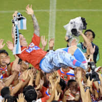 Sagan Tosu striker Fernando Torres is lifted into the air by teammates following the final game of his career on Friday at Ekimae Real Estate Stadium in Tosu, Saga Prefecture. | KYODO