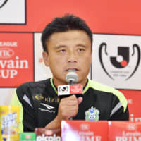 Shonan manager Cho Kwi-jea speaks at an Oct. 26 news conference before the 2018 Levain Cup final at Saitama Stadium. | KYODO