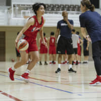 Maho Hayashi participates in a workout during last week's Basketball Without Borders Asia Camp in Tokyo.   NBAE