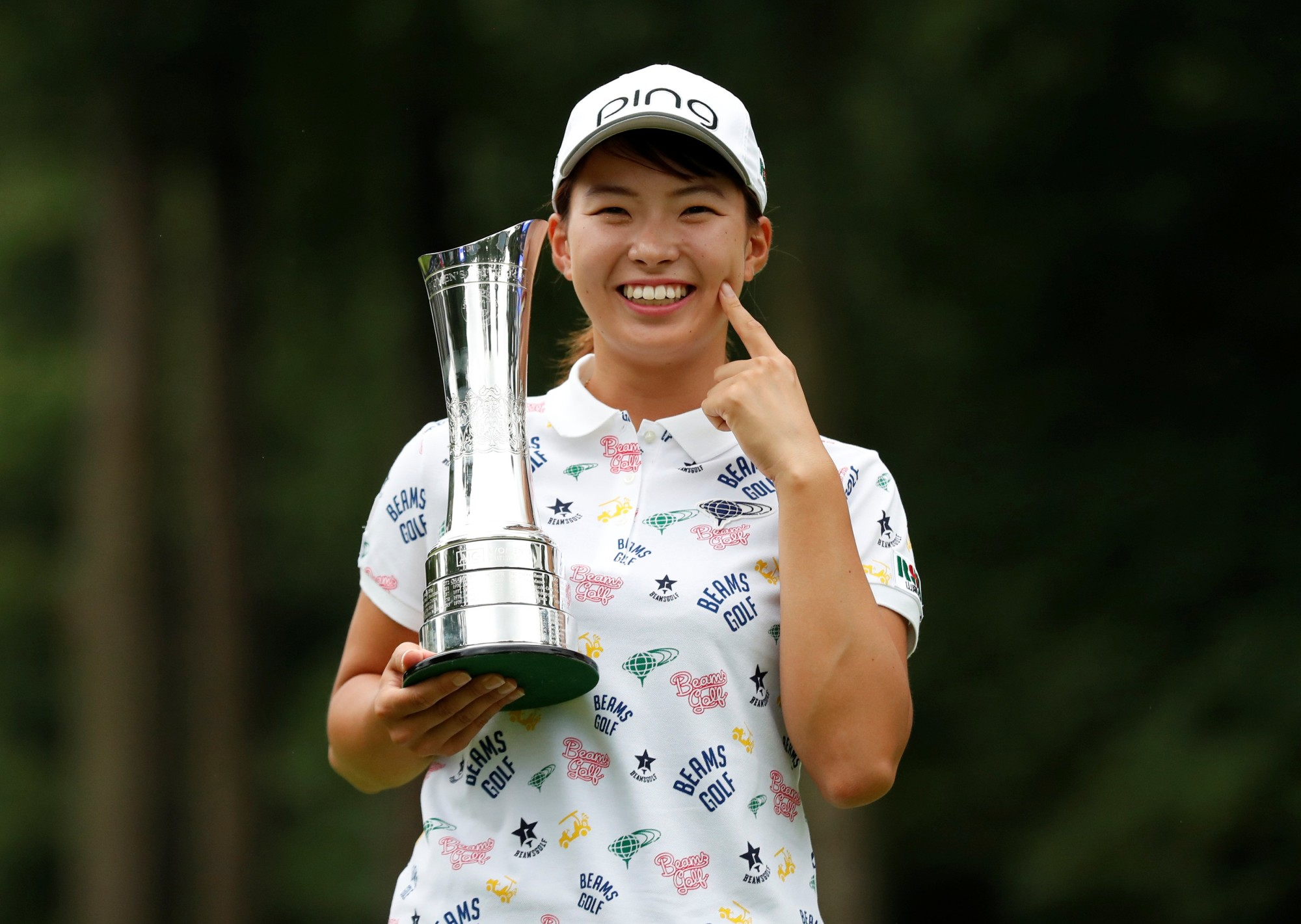 Hinako Shibuno holds the trophy as she poses for photos following her victory at the Women's British Open on Sunday in Milton Keynes, England.   ACTION IMAGES VIA REUTERS