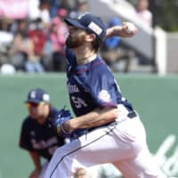 The Lions' Zach Neal pitches against the Fighters on Tuesday at Kushiro Stadium. Seibu routed Hokkaido Nippon Ham 8-2. | KYODO
