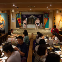 A sumo-themed restaurant run by O-Sumo San Promotions in Ryogoku, Tokyo, has a regulation ring surrounded by tables.   JOHN GUNNING