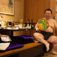 Shunba chats with a guest during a break between bouts earlier this month at a sumo-themed restaurant in Ryogoku, Tokyo.   JOHN GUNNING