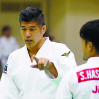 Japan judo coach Kosei Inoue gives instructions during a training camp in Nobeoka, Miyazaki Prefecture, on Aug. 5. | KYODO