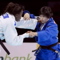Shori Hamada (right) competes against France's Madeleine Malonga in the women's 78-kg division final at the World Judo Championships on Friday at Nippon Budokan. Hamada earned the silver medal.   KYODO