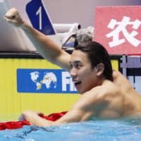Katsuhiro Matsumoto reacts after earning the silver medal in the men's 200-meter freestyle in a new Japan record of 1 minute, 45.22 seconds at the world championships in Gwangiu, South Korea, on July 23. | KYODO