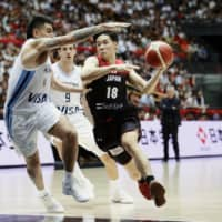 Argentina's experience pays off in victory over Japan