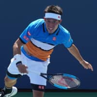 Kei Nishikori of Japan returns the ball against Marco Trungelliti of Argentina during their Round 1 the Men's Singles match at the 2019 US Open at the USTA Billie Jean King National Tennis Center in New York on Monday. | AFP-JIJI
