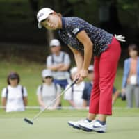 Hinako Shibuno putts on the 12th hole in the first round of the Hokkaido Meiji Cup on Friday at Sapporo International Country Club. Shibuno, last weekend's winner at the Women's British Open, shot a 2-under 70 at Sapporo International Country Club. | KYODO