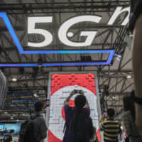 Signage for 5G is displayed at the China Unicom Hong Kong Ltd. booth at the MWC Shanghai exhibition in June. | BLOOMBERG
