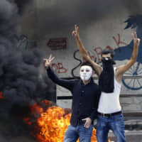 Lebanese demonstrators decry deteriorating economic conditions, chant 'down with capitalism'