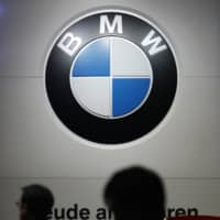 BMW's logo is displayed at the Tokyo Motor Show 2011. | BLOOMBERG