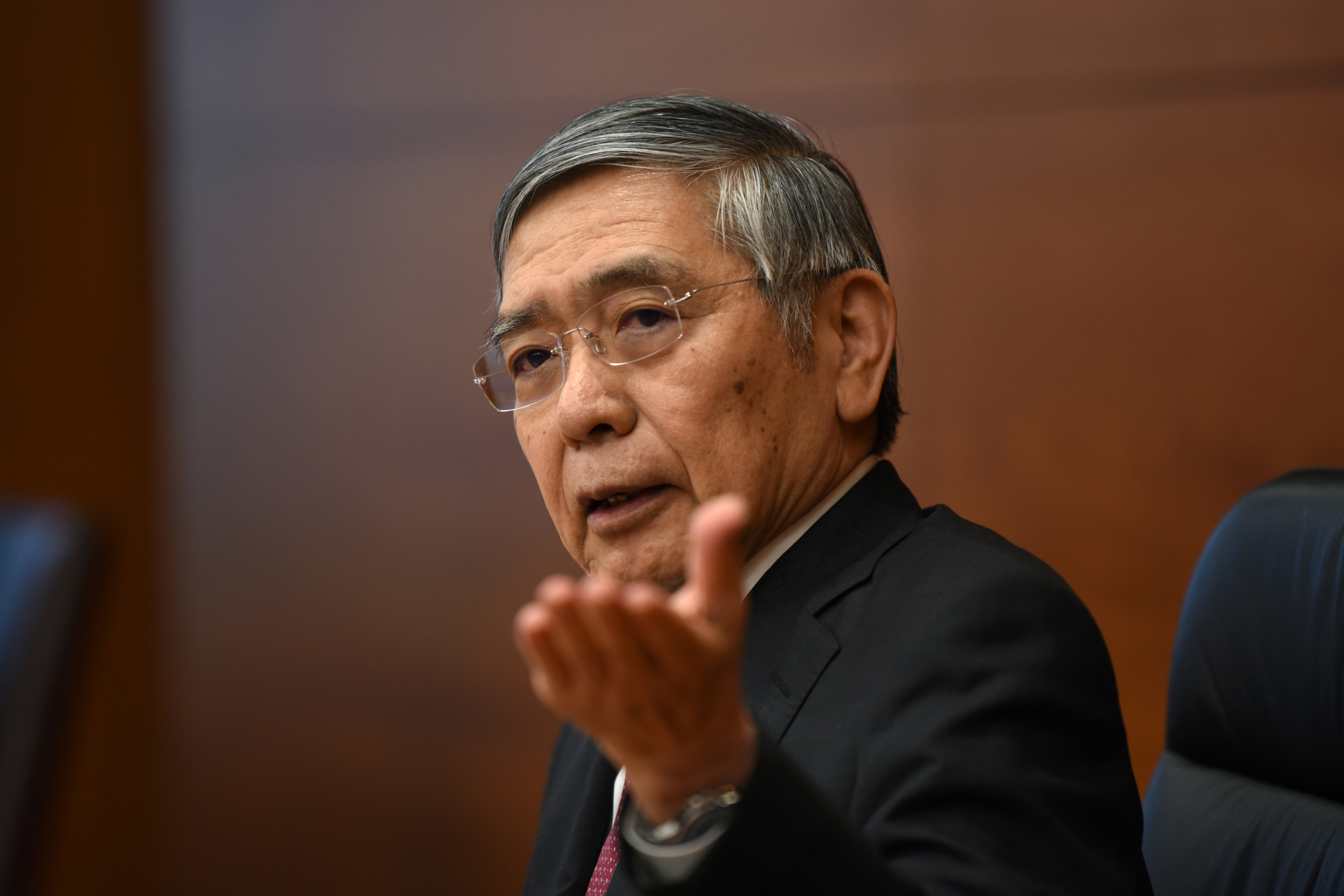Bank of Japan Gov. Haruhiko Kuroda gestures at a news conference at the central bank's headquarters in Tokyo on Sept. 19. | BLOOMBERG