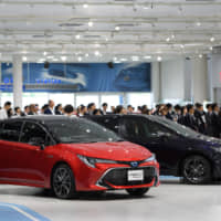 A Corolla Sport vehicle (left) and a Corolla Touring vehicle, both manufactured by Toyota Motor Corp., sit on display during an unveiling event in Tokyo on Tuesday.