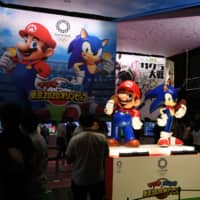 Characters of Nintendo's franchise Mario and Sega's Sonic the Hedgehog are seen at a promotional booth for the video game 'Mario & Sonic at the Olympic Games Tokyo 2020' during the Tokyo Game Show in Makuhari, Chiba Prefecture, on Thursday. | AFP-JIJI