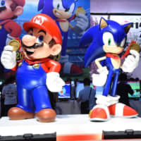 Nintendo Co. character Mario and Sega Games Co.'s Sonic the Hedgehog are displayed in a promotional booth for the video game Mario & Sonic at the Olympic Games Tokyo 2020 at the Tokyo Game Show in Makuhari, Chiba Prefecture, on Thursday. | DAN ORLOWITZ