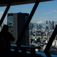 Japan's economic growth revised downward as capital investment slows