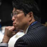 Hiro Mizuno, executive managing director and chief investment officer of Japan's Government Pension Investment Fund, listens during the Bloomberg Global Business Forum in New York on Wednesday. | BLOOMBERG