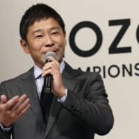 Zozo Chief Executive Yusaku Maezawa speaks during a news conference on the PGA Tour in Tokyo in November 2018. | AP