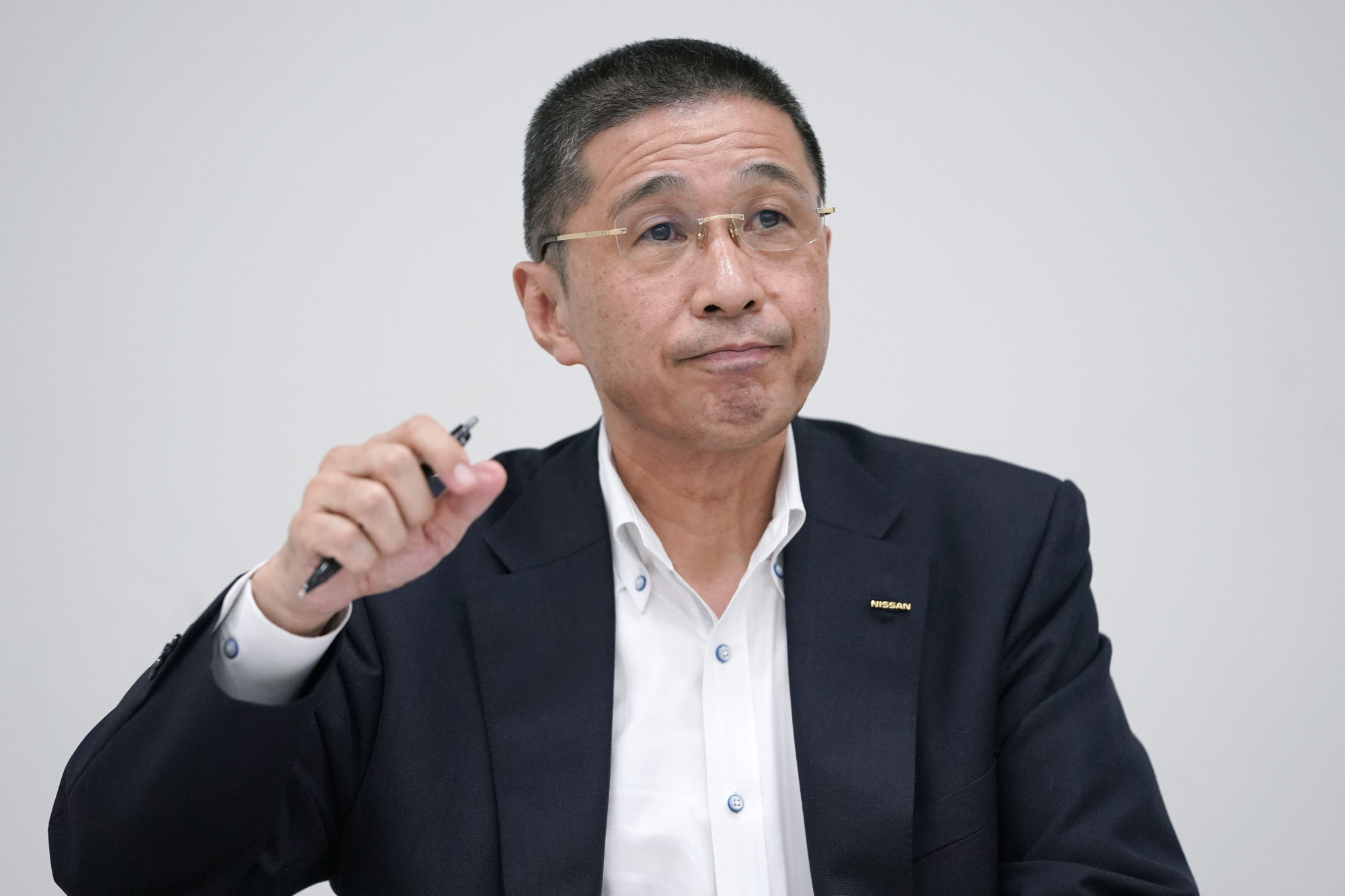 Hiroto Saikawa, chief executive officer of Nissan Motor Co., speaks during a news conference at the company's headquarters in Yokohama on Sept. 9. Saikawa stepped down Monday. He'll be replaced by Chief Operating Officer Yasuhiro Yamauchi until a permanent replacement is named by the end of October.   BLOOMBERG