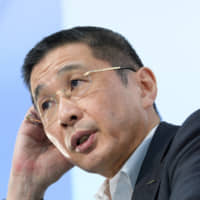 Hiroto Saikawa, president and chief executive officer of Nissan Motor Co., speaks at a news conference at the company's headquarters in Yokohama on July 25. | BLOOMBERG
