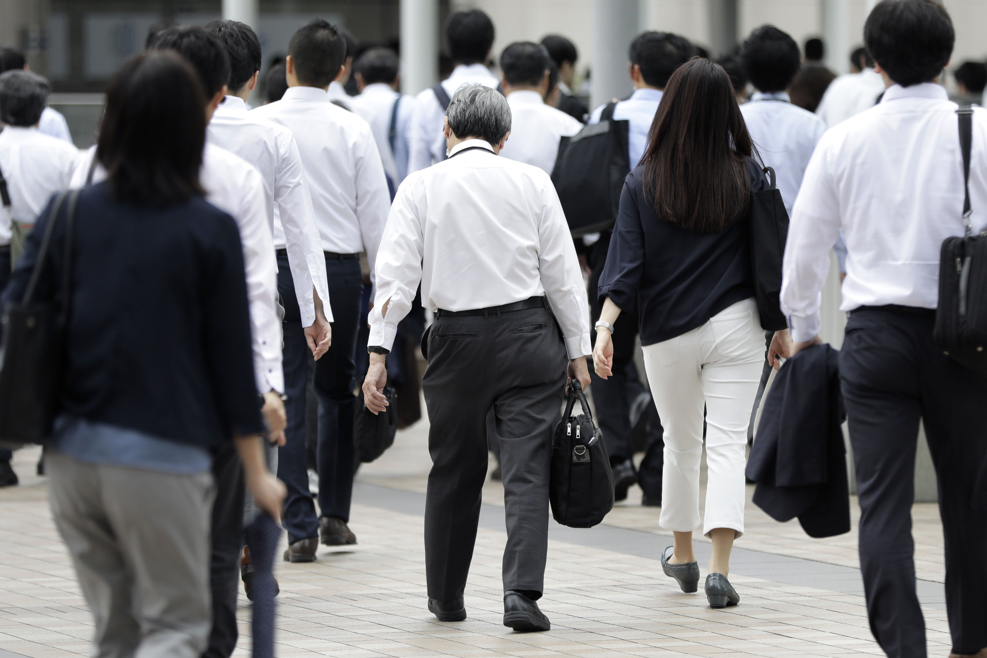 People aged 50 or above and out of Japan's workforce could increase 29 percent to 59 per 100 people by 2050, the OECD says in a new report. | BLOOMBERG