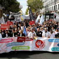 Doctors, lawyers and pilots protest in Paris over Macron's pension reforms