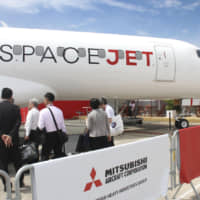 A SpaceJet is shown at the International Paris Air Show in Le Bourget, Paris, on June 18. | KYODO