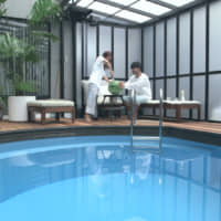 Taking the plunge: Risako (left) and Kenny furthered their relationship with a date involving a watermelon and an indoor pool on 'Terrace House Tokyo 2019-2020.' | © FUJI TELEVISION / EAST ENTERTAINMENT