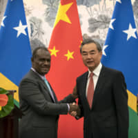 Solomon Islands minister signs pact to establish diplomatic ties with China