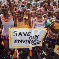 People take part in a protest for climate action on Friday in Durban, South Africa. | AFP-JIJI