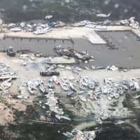 In this image courtesy of U.S. Coast Guard Air Station Clearwater, boats are strewn across a marina in the Bahamas on Monday as Hurricane Dorian makes its way across the Bahamas. | HO / US COAST GUARD / VIA AFP-JIJI