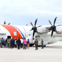 Prime Minister Hubert MInnis boards a U.S. Coast Guard plane en route to Abaco for a reconnaissance flight to survey damage caused by Hurricane Dorian, in Nassau Tuesday. | JOHN MARC NUTT / VIA REUTERS