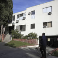 The building housing the apartment of Ed Buck in West Hollywood, California, is seen in January, following the death of a man the previous day. The prominent LGBTQ political activist was arrested Tuesday and charged with operating a drug house and providing methamphetamine to a 37-year-old man who overdosed on Sept. 11, but survived, officials said.   AP