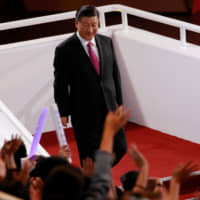 Chinese President Xi Jinping arrives at the opening ceremony of the FIBA World Cup in Beijing on Friday. | REUTERS