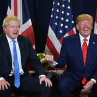 U.S. President Donald Trump and British Prime Minister Boris Johnson (left) meet Tuesday at U.N. Headquarters in New York on the sidelines of the United Nations General Assembly.   AFP-JIJI