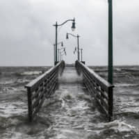 Strong gusts of wind and bands of heavy rain cover a walkway at the Jensen Beach Causeway Park in Jensen Beach, Florida, Tuesday. Weakening slightly but still packing a powerful punch, Hurricane Dorian churned toward the southeastern coast of the United States after delivering a devastating blow to the Bahamas. | AFP-JIJI