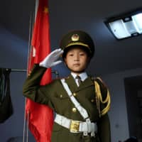 China's 9-year-old 'national flag baby' captivates millions with daily patriotic ritual