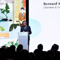 Chairman and Chief Executive of LVMH Bernard Arnault delivers a speech during the presentation of the group's environmental 'Life' program (LVMH Initiatives For the Environment) on Wednesday at LVMH headquarters in Paris. | AFP-JIJI