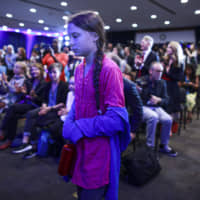 Activist Greta Thunberg attends a press conference where 16 children from across the world present their official human rights complaint on the climate crisis to the United Nations Committee on the Rights of the Child at the UNICEF Building on Monday in New York City. | AFP-JIJI