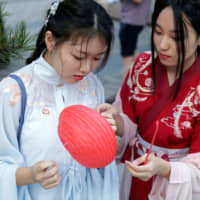 Young Chinese women give tradition a nod by wearing Hanfu costumes