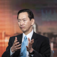 Bernard Chan, a top adviser to Hong Kong's government, speaks during a television interview in Hong Kong on June 17. | BLOOMBERG