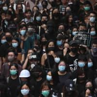 Students attend a rally at the University of Hong Kong on Monday to highlight the five demands protesters are asking from the government. | AFP-JIJI