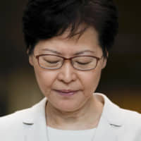 Chief Executive Carrie Lam holds a news conference at the Hong Kong government building on Thursday.   AP