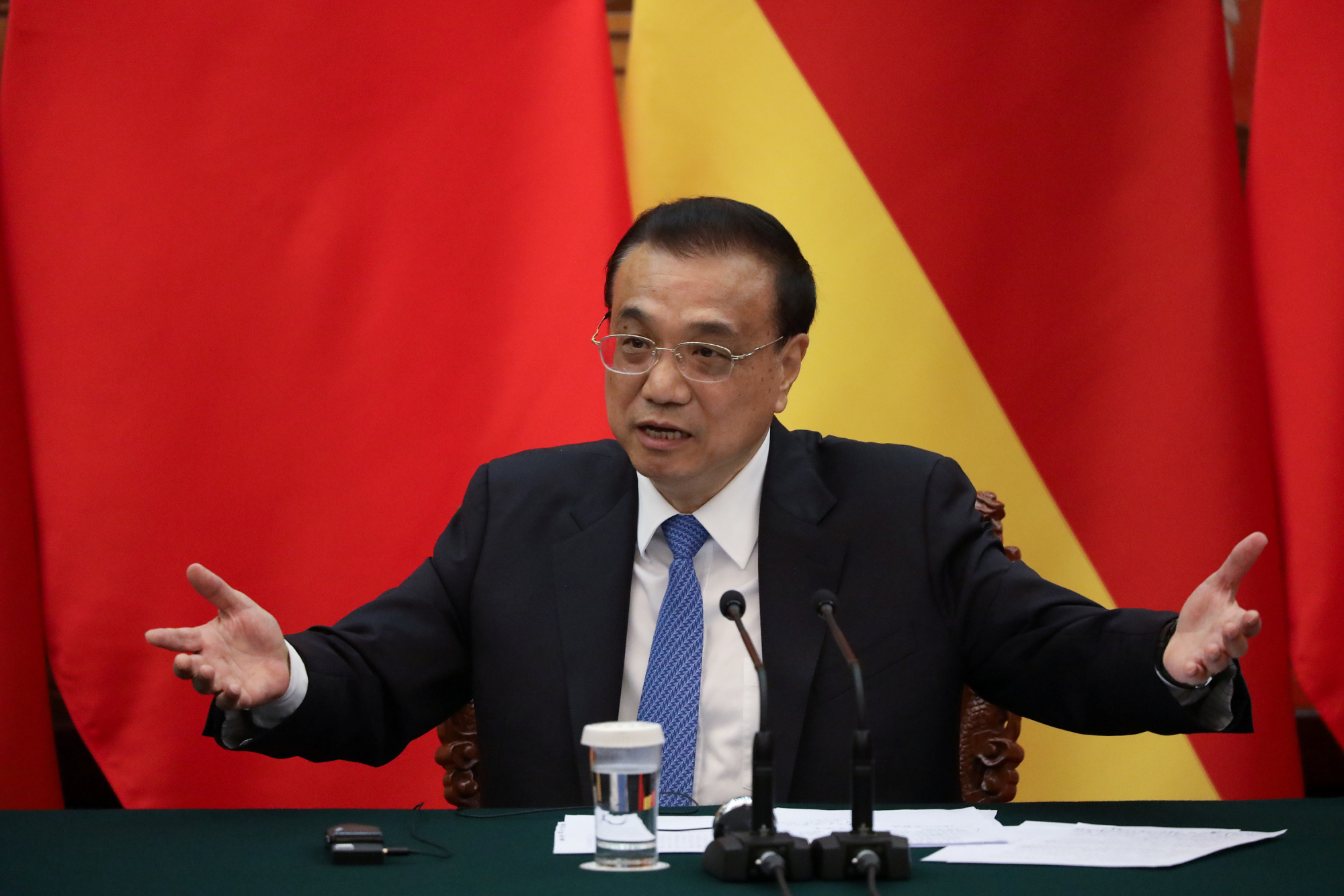 Chinese Premier Li Keqiang gives a speech during the news conference at the end of a meeting with German Chancellor Angela Merkel at the Great Hall of the People in Beijing on Friday. | REUTERS