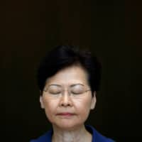 Hong Kong Chief Executive Carrie Lam at a news conference in August | REUTERS